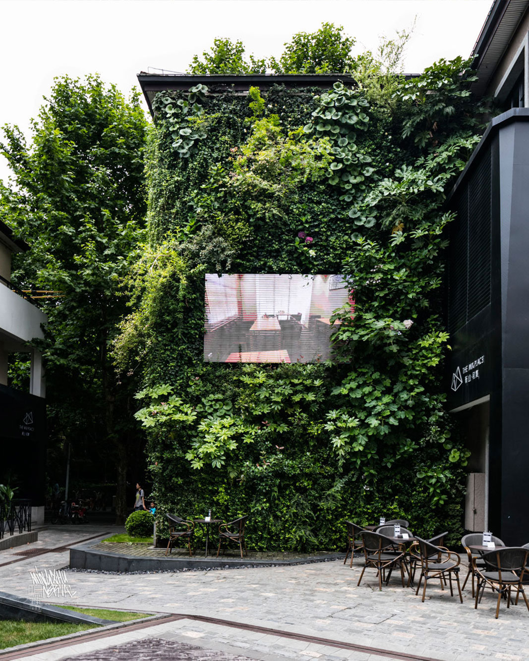 Mingzhu Nerval vertical living wall experts created a sustainable city architecture for the Mixed Place in Shanghai, 2016